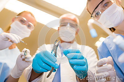 Professional dental team in action bottom view