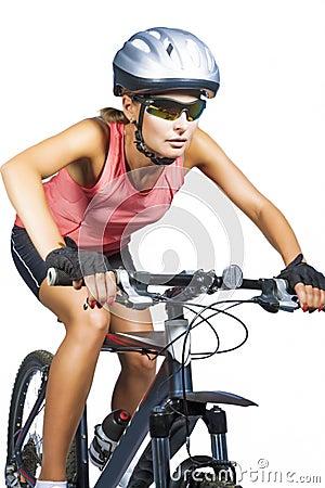 Professional female cycling athlete riding mountain bike wearing