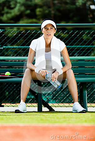Professional female tennis player rests