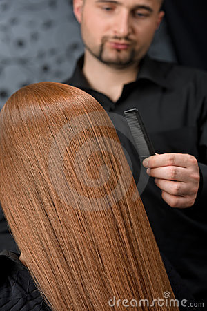 Professional hairdresser at luxury salon