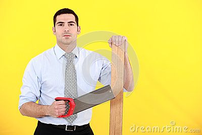 Professional holding a saw