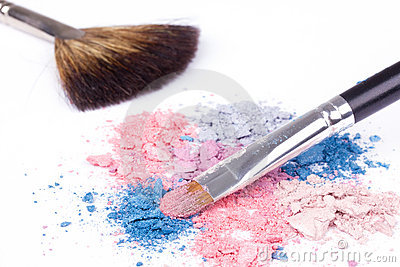Professional make-up brushes on colour eyeshadows