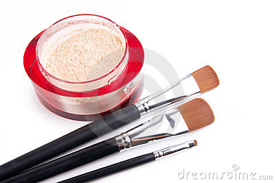 Professional make-up brushes and powder on white