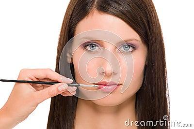 Professional makeup model woman apply  lipstick