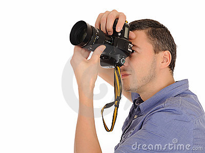 Professional male photographer taking picture