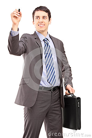 Professional man with a briefcase writing something imaginary