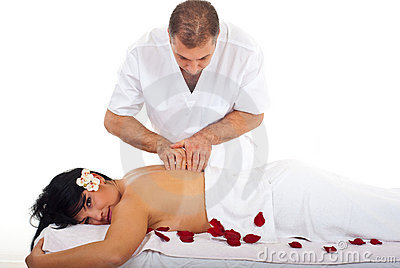 Professional masseur giving woman massage