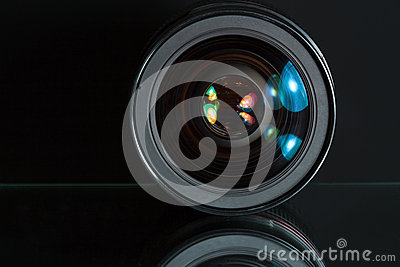 Professional photo lens in dark background