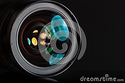 Professional photo lens in dark background
