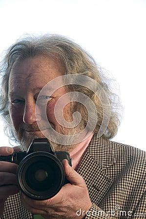 Professional photographer senior man long hair