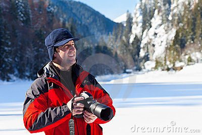Professional photographer in the winter landscape
