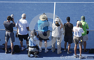 Professional photographers on tennis court during US Open 2013 trophy presentation at the Arthur Ashe Stadium Editorial Stock Photo