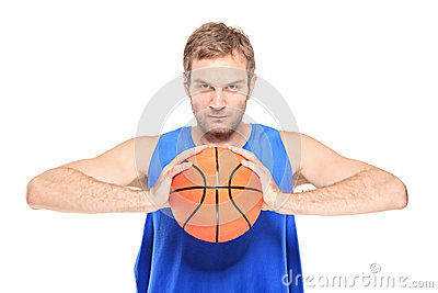 Professional sportsman holding a basketball