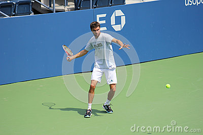 Professional tennis player Gilles Simon practices for US Open at Billie Jean King National Tennis Center Editorial Photo