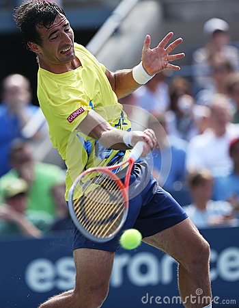 Professional tennis player Ivan Dodig during third round singles match at US Open 2013 Editorial Image