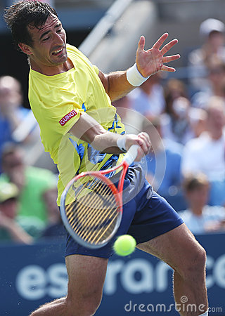Professional tennis player Ivan Dodig during third round singles match at US Open 2013 Editorial Stock Image