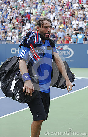 Professional tennis player Marcos Baghdatis from Cyprus leaving Louis Armstrong stadium after third round match loss at US Open Editorial Stock Photo