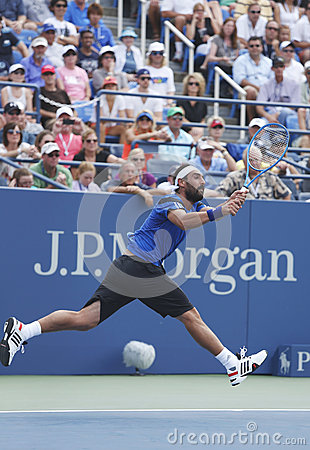 Professional tennis player Marcos Baghdatis during third round match at US Open 2013 against Stanislas Wawrinka Editorial Stock Image