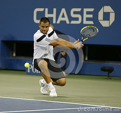Professional tennis player Mikhail Youzhny during  quarterfinal match at US Open 2013 against  Novak Djokovic Editorial Photo