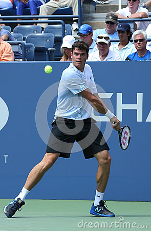 Professional tennis player  Milos Raonic during first round singles match at US Open 2013 Editorial Stock Image