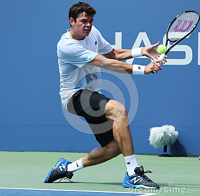 Professional tennis player  Milos Raonic during first round singles match at US Open 2013 Editorial Stock Photo