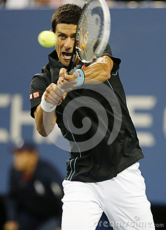 Professional tennis player Novak Djokovic during  quarterfinal match at US Open 2013 against Mikhail Youzhny Editorial Stock Image