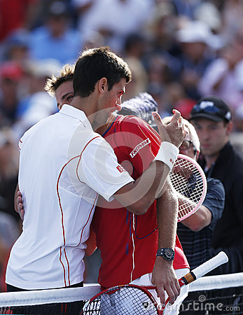 Professional tennis players Stanislas Wawrinka and Novak Djokovic after semifinal match at US Open 2013 Editorial Stock Image