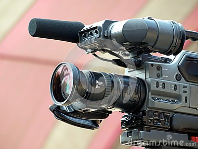 Professional Video Camera with Attached Microphone Editorial Stock Image