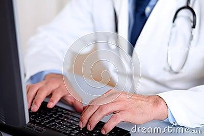 Professionals doctor hands working on computer