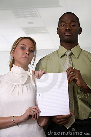 Professionals holding blank white notebook