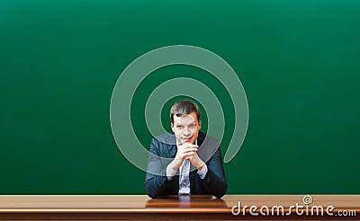 Professor against chalkboard