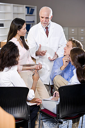 Free Professor Having Discussion With College Students Stock Images - 14702304