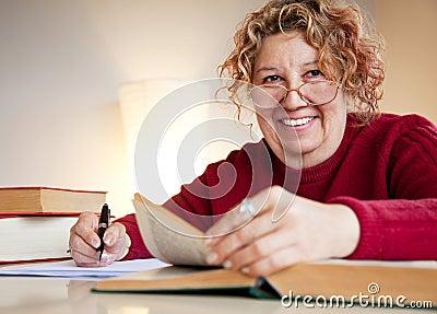 Professor over books smiling