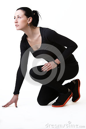 Sporty woman ready to sprint