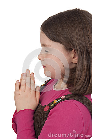 Profile of beautiful girl praying with closed eyes