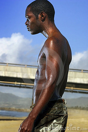 Profile of black man on beach
