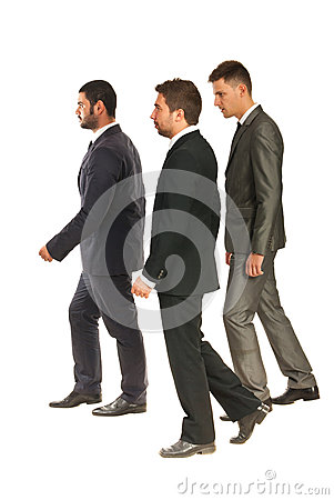Profile of business men walking