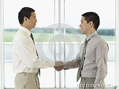 Profile Of Businessmen Shaking Hands