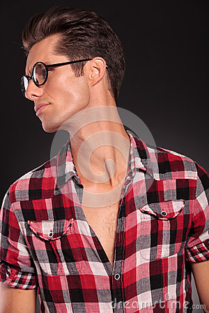 Profile of a casual young man wearing glasses