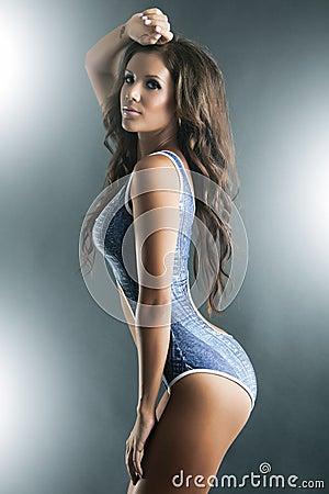 Profile of a gorgeous woman inone piece bikini