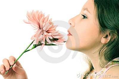 Profile of inspired girl child with flower.