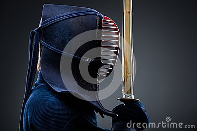 Profile of kendo fighter with shinai
