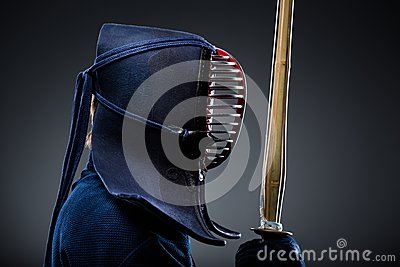 Profile of kendoka with shinai
