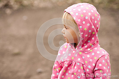 Profile of a little girl in a hood