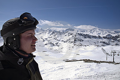 Profile of male skier with the mountains