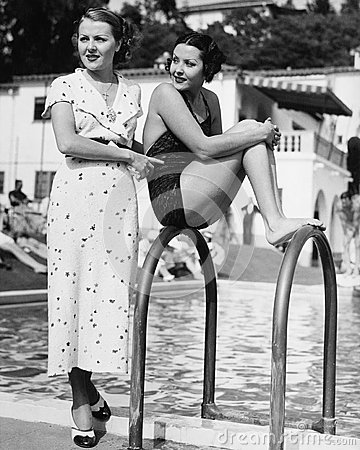 Free Profile Of A Young Woman Sitting On A Ladder At The Pool Side With Another Woman Standing Behind Her Stock Images - 52021704