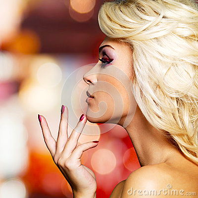 Profile portarit of glamour woman with red nails