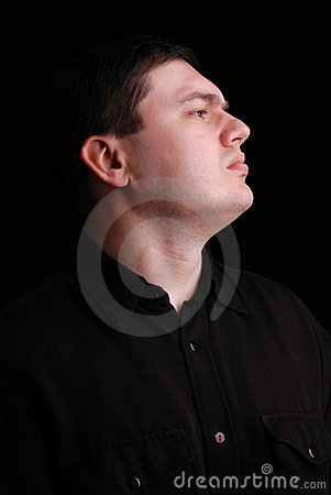 Profile portrait of man on black