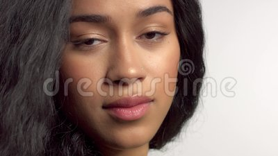 Beauty mixed race african american model in studio portraits with long hair wig. Profile portrait of mixed race model turning to the camera with blowing hair stock footage