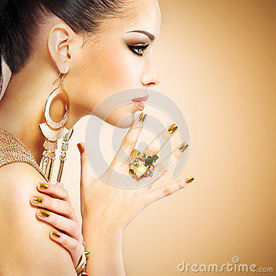 Free Profile Portrait Of The Fashion Woman With Beautiful Golden Mani Stock Image - 45356841